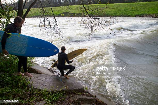 Surfers scout a standing wave on the Trinity River on March 19, 2020 in Fort Worth, Texas. Local surfers searched out standing waves in flooded...