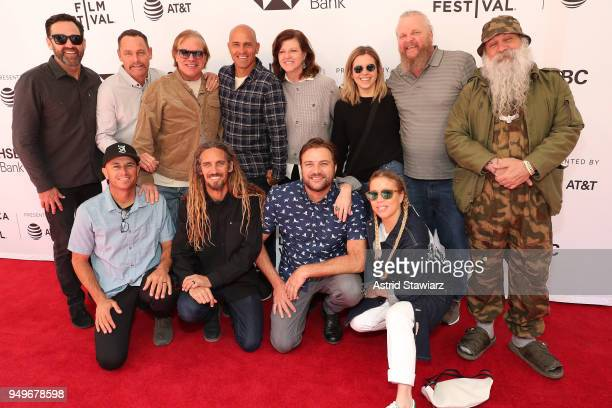 Surfers Taylor Knox Taylor Steele Rob Machado Kelly Slater Shane Dorian and Benji Weatherley pose with guests at screening for Momentum Generation...
