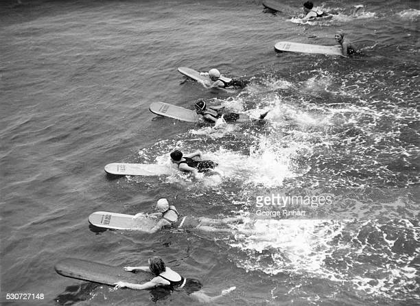 Surfers train for the surfing championship of southern California Their training ground is a 600yard course off Hermosa Beach The surfing...