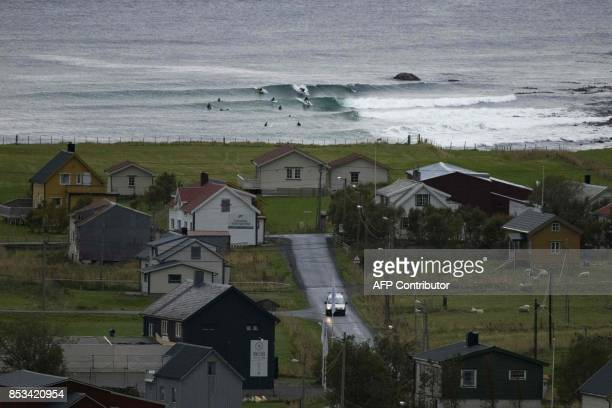 Surfers warm up during the Lofoten Masters 2017 the world's most northerly surf competition in Unstad's bay in the arctic circle on September 23 2017...
