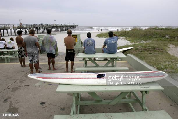 Surfers watch others ride the big wave at the Oceanana Fishing Pier as Hurricane Earl approaches Atlantic Beach North Carolina Thursday September 2...
