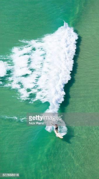 Surfing a breaking wave near Noosa in Queensland