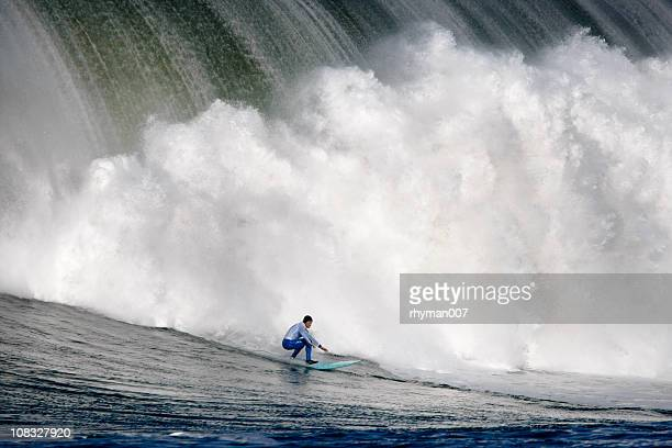 surfing a huge wave - big wave surfing stock pictures, royalty-free photos & images