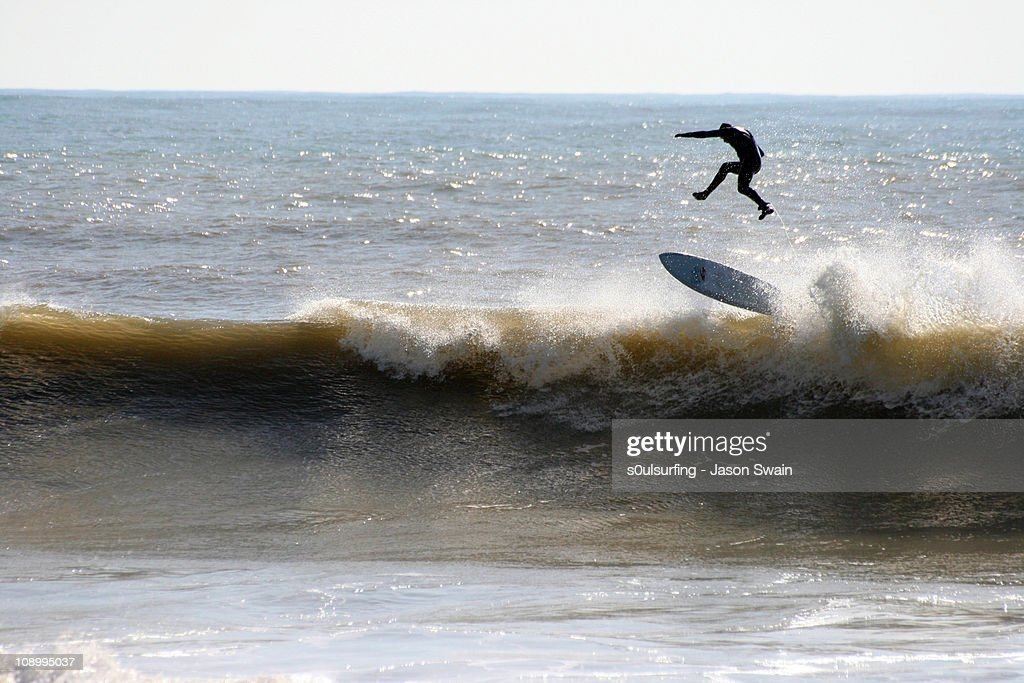 Surfing at Freshwater Bay, Isle of Wight. Gravity : Stock Photo
