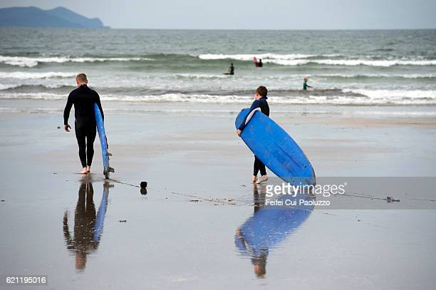 Surfing at Inch beach of Kerry County in Ireland