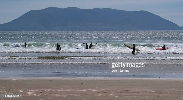 surfing at inch, ireland - inch stock pictures, royalty-free photos & images