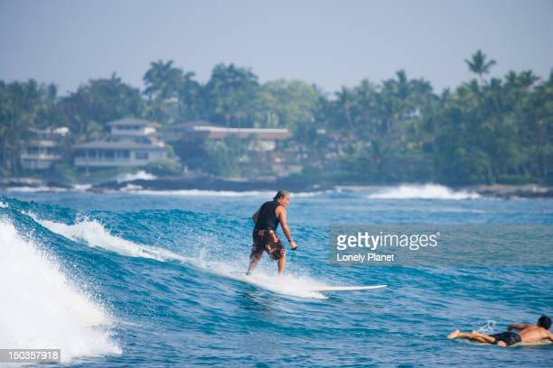 surfing at lyman's beach, kailua kona. - kailua beach stock photos and pictures