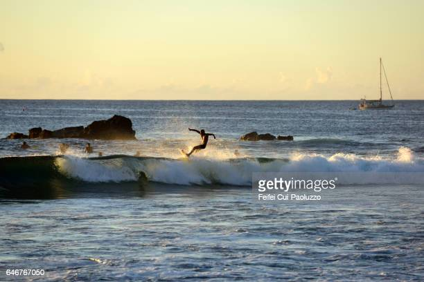 Surfing at pacific ocean in Hanga Roa of Easter Island i Chile