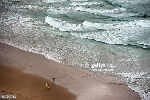 Surfing at Praia da Arrifana Beach of Algarve Region Portugal