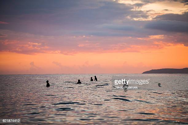 Surfing at sunset in Sumba, Indonesia