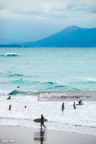 surfing in biarritz, france - aquitaine stock photos and pictures