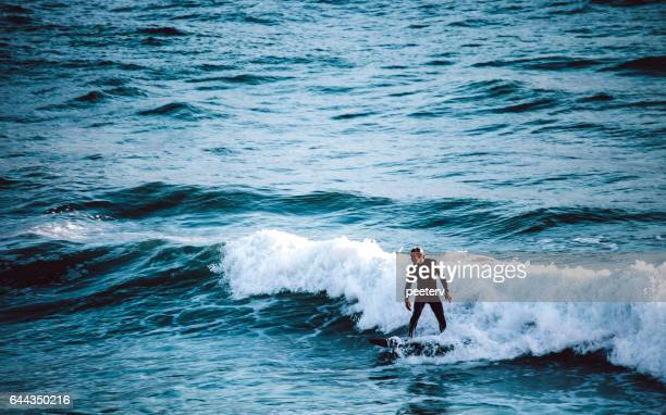surfing in california. - carlsbad california stock pictures, royalty-free photos & images
