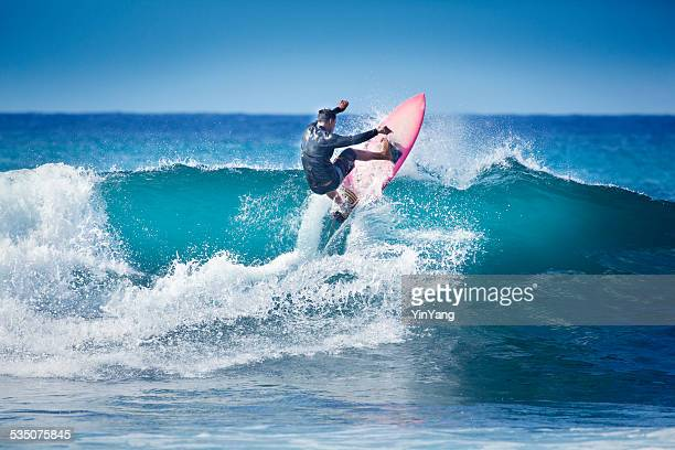 surfing in kauai hawaii - breaking wave stock pictures, royalty-free photos & images