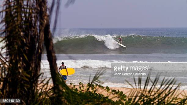 surfing in the atlantic ocean - gabon stock pictures, royalty-free photos & images