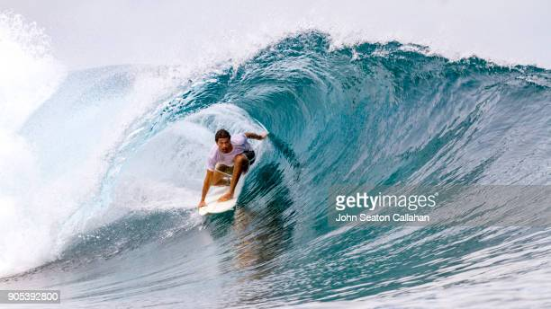 surfing in the mentawai islands - breaking wave stock pictures, royalty-free photos & images