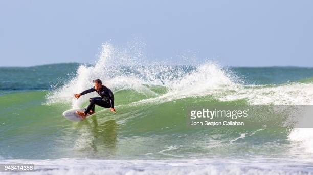 surfing in western sahara - wetsuit stock pictures, royalty-free photos & images