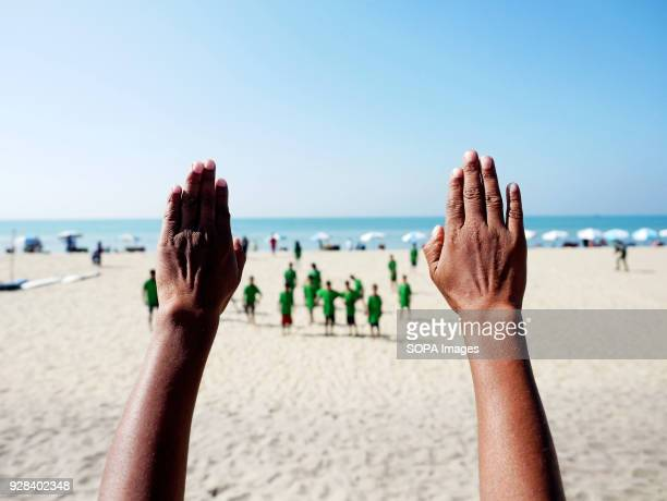A surfing instructor seen leading the young surfer for warm up Young people in the world´s longest sandy beach in Cox´s Bazar Bangladesh decided to...