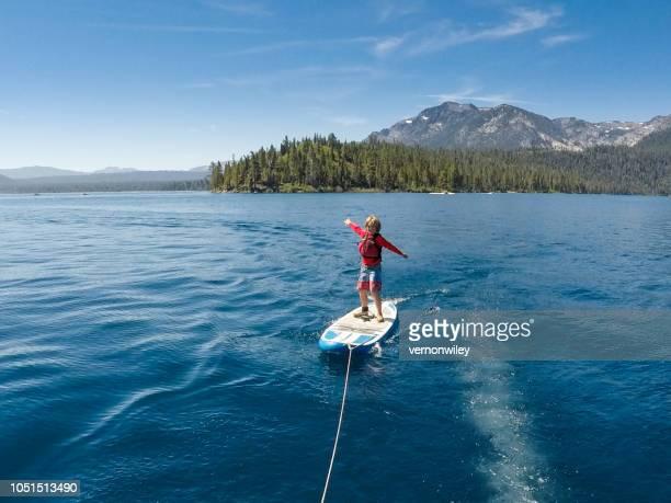 surfing lake tahoe - emerald bay lake tahoe stock pictures, royalty-free photos & images