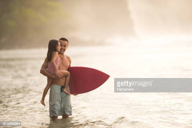surfing lesson from dad - pacific islander stock pictures, royalty-free photos & images