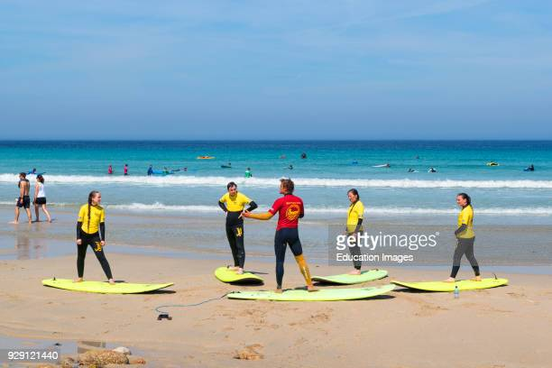 Surfing Lessons On The Beach At Sennen Cove In Cornwall England Uk