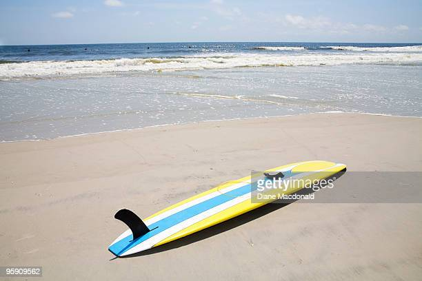 A surfing longboard at the beach