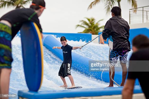 Surfing on an artificial wave at Sentosa Beach.
