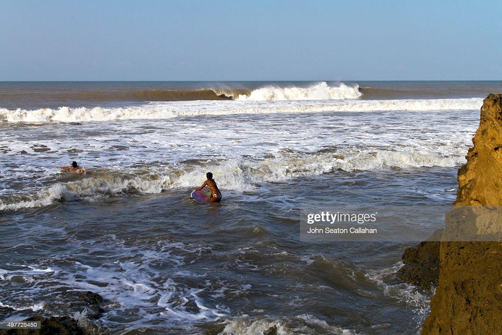 Surfing on Diu Island : Stock Photo