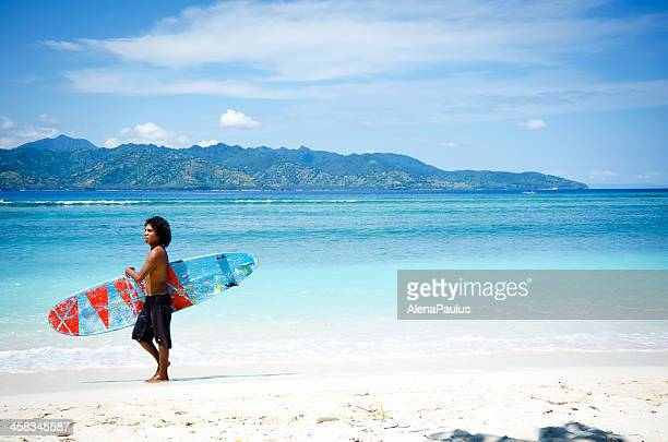 surfing on gili islands near lombok, indonesia - gili trawangan stock photos and pictures
