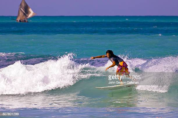 surfing on the ile a vache - vache stock photos and pictures