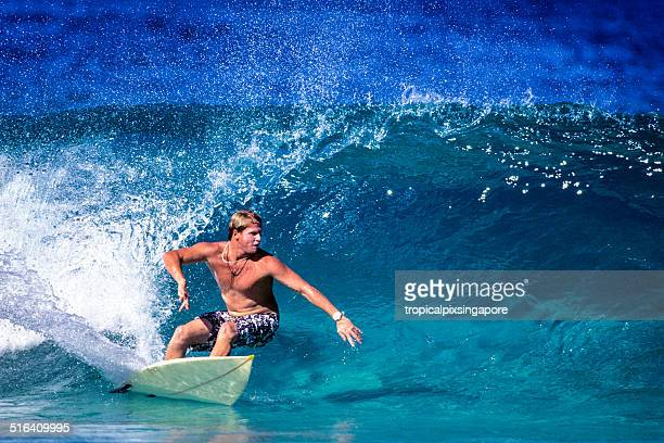 surfing on the north shore - waimea bay stock photos and pictures