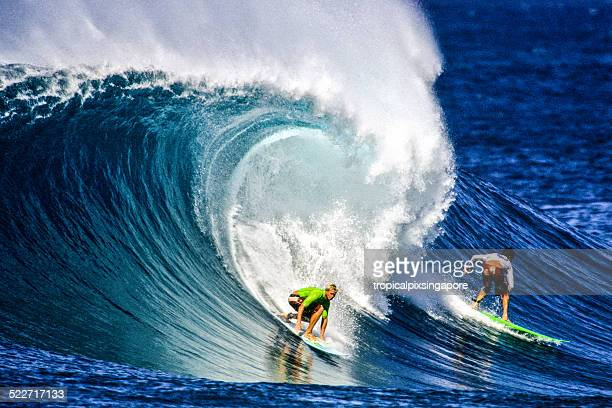 surfing on the north shore - north shore stock photos and pictures