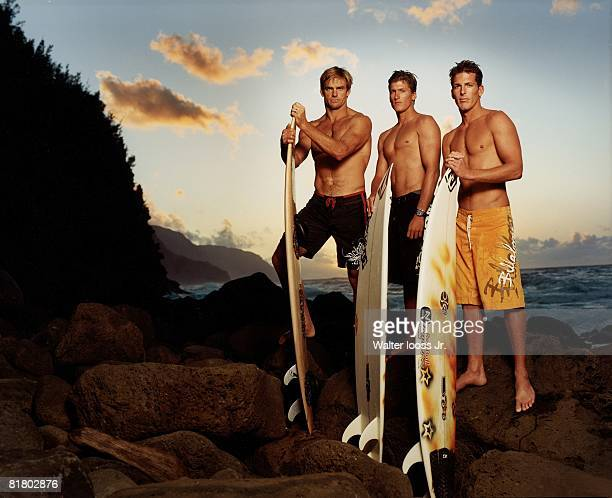 Surfing Portrait of Laird Hamilton Bruce Irons and his brother Andy Irons with boards equipment Kauai HI 2/1/2005