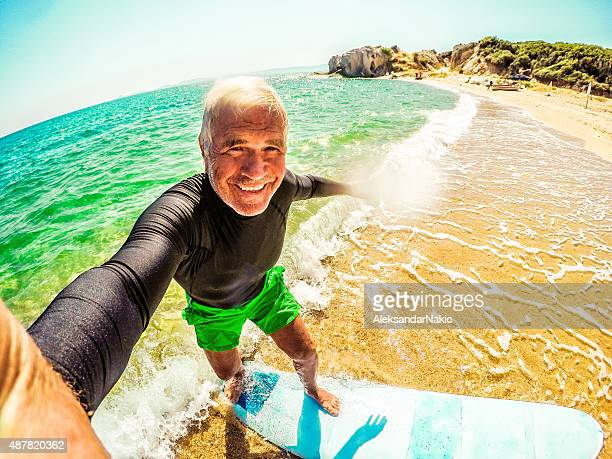 Surfing selfie of a senior man