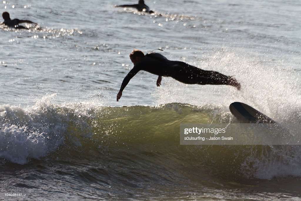 Surfing silhouette : Stock Photo