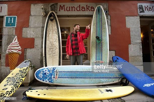 Surfing teacher Mike Dobos poses in front of his Surfin' Mundaka school on November 21 2012 in the northern Spanish Basque village of Mundaka Rather...