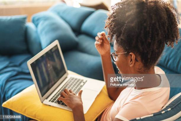surfing the internet - teenage girls stock pictures, royalty-free photos & images