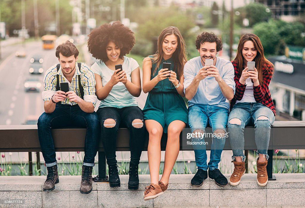 Surfing the net in the city : Stock Photo
