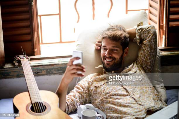 surfing the net. - maxim musician stock photos and pictures