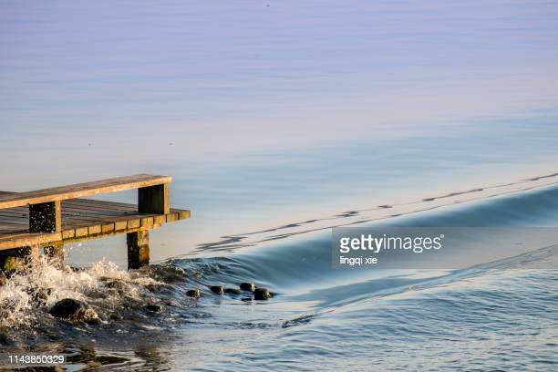 Surfing the waves on the landing stage