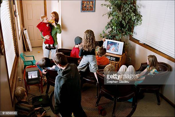 Surfing the web, playing video games and watching TV are among the childrenÕs favorite activities in this polygamist family from the Salt Lake...