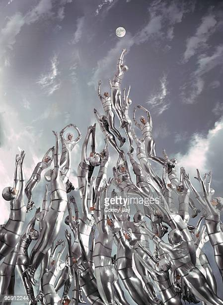 Surge of silver suited figures reaching for moon