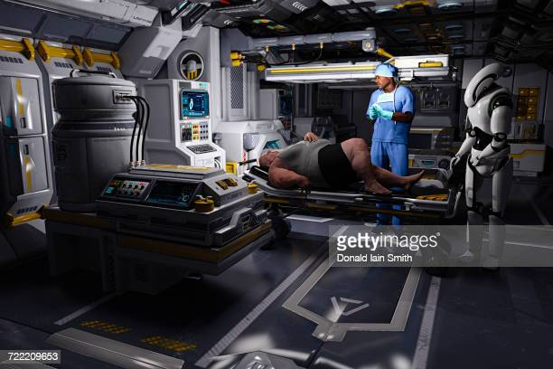 Surgeon and cyborg watching obese man on table