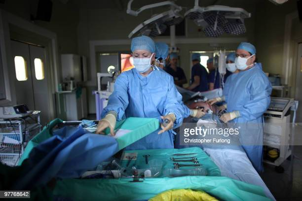 A surgeon and his theatre team perform key hole surgery to remove a gallbladder at at The Queen Elizabeth Hospital on March 16 2010 in Birmingham...