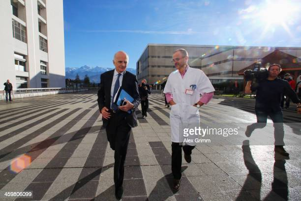 Surgeon and Michael Schumacher's friend professor Gerard Saillant and Professor JeanFrancois Payen leave a press conference at Grenoble University...