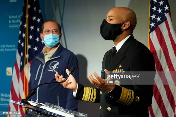 Surgeon General Dr. Jerome Adams speaks as Health and Human Services Secretary Alex Azar listens at George Washington University Hospital on December...