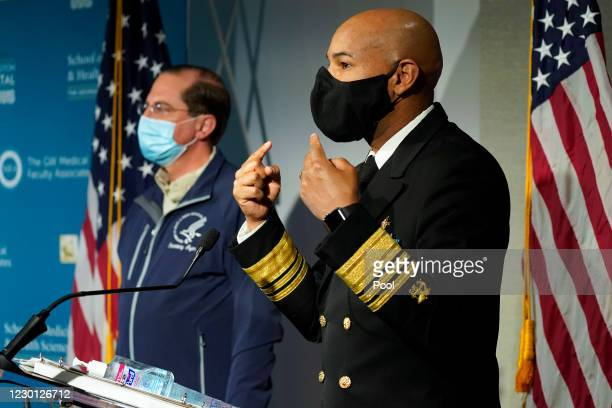 Surgeon General Dr. Jerome Adams talks about the need to still wear face masks as U.S. Health and Human Services Secretary Alex Azar listens at...