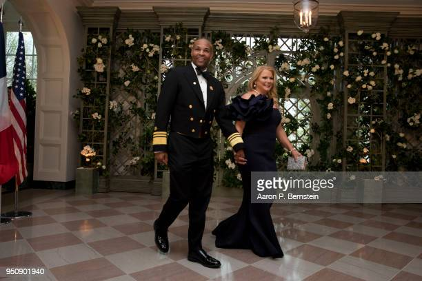 S Surgeon General Jerome Adams and his wife Stacey arrive at the White House for a state dinner April 24 2018 in Washington DC President Donald Trump...