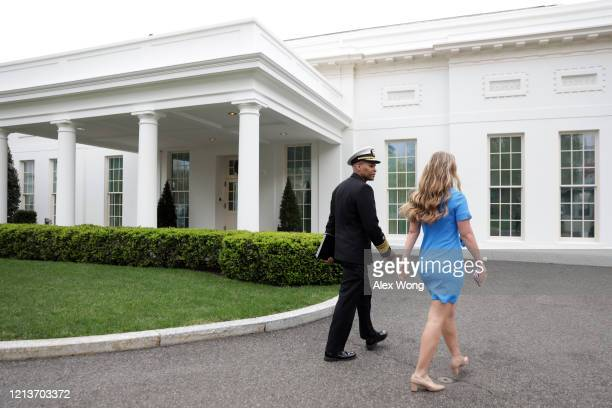 S Surgeon General Jerome Adams arrives at the White House March 20 2020 in Washington DC The US Senate is working on a legislation to help on the...