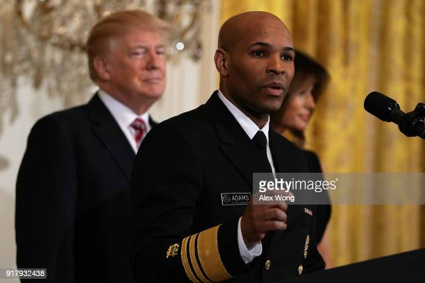 S Surgeon General Jerome Adams speaks as President Donald Trump and first lady Melania Trump look on during a reception in the East Room of the White...