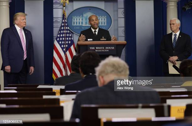 S Surgeon General Jerome Adams speaks as US President Donald Trump and Vice President Mike Pence look on during the daily briefing of the White House...